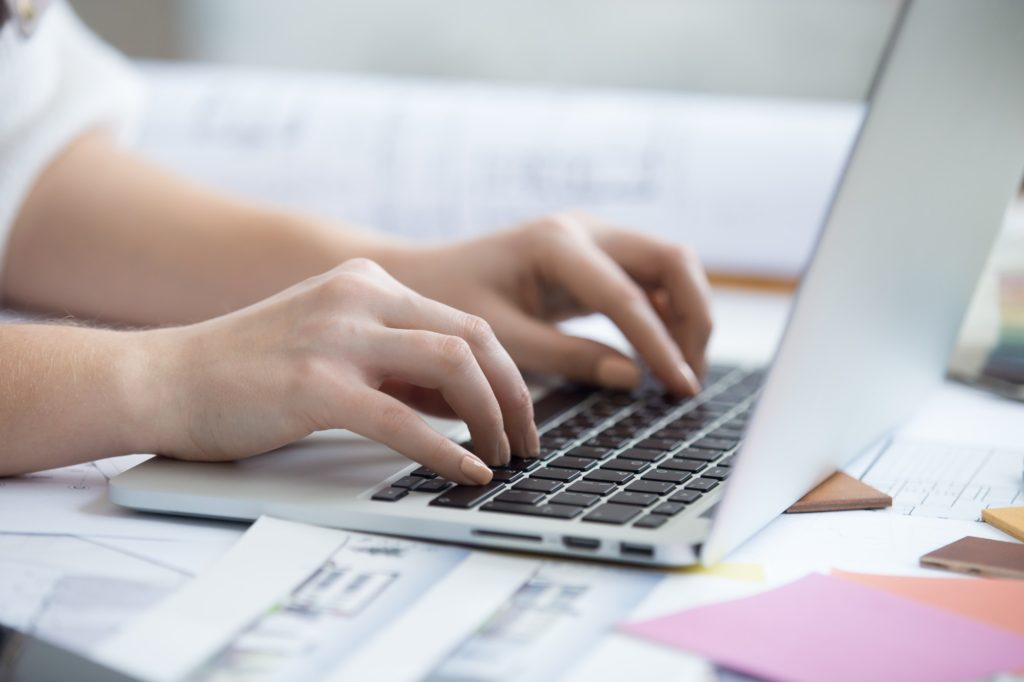 Typing on laptop, close-up