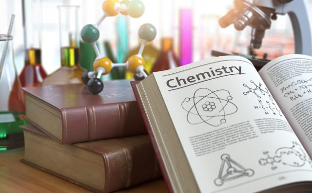 Chemistry education concept. Open books with text chemistry and